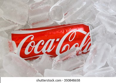 Nakronratchasima , Thailand -DECAMBER 13 ,2015 : Coke can on ice. Coke is popular flavored soft drink created by Coca-Cola company.