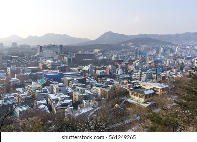 naksan park stone wall covered in snow with the view of the city in the back. Taken in Seoul, South Korea