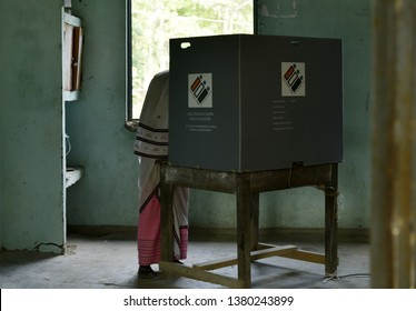 Nalbari, Assam, India. 18 April, 2019. An Indian voter casts  vote at a polling station during India's general election in Nalbari, Assam under Mangaldoi  Constiturncy.