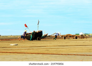 Nam Dinh, VIETNAM - August 10 2014: Fishermen brought the boat to shore at Haily. This location is famous for salt production and aquaculture.