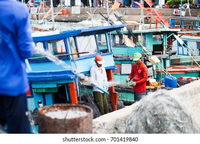 NAM DU, VIETNAM - JULY 27, 2017: Local fishermen working on their boats in Hon Tre pier, early morning, Nam Du Islands, Kien Giang, Vietnam