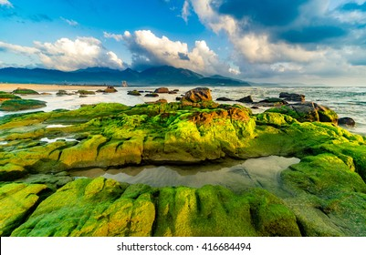 Nam O Beach, Da Nang Beach is a beautiful beach in Danang city , Vietnam.   Beautiful moss rocks at the beach is interesting for travel and take a photo.