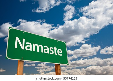 Namaste Green Road Sign with Copy Room Over The Dramatic Clouds and Sky.