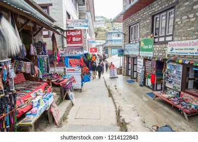 Namche Bazaar, Nepal : October-14-2018 :  The clothing and souvenir shops in the main street of Namche Bazaar. Namche Bazaar is a tourist hub and the most popular resting stop in the Khumbu region.