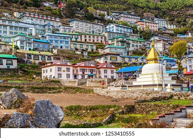 Namche Bazar, Nepal - October 26, 2018: View at the colorful houses on the hill in Namche Bazar, Nepal.