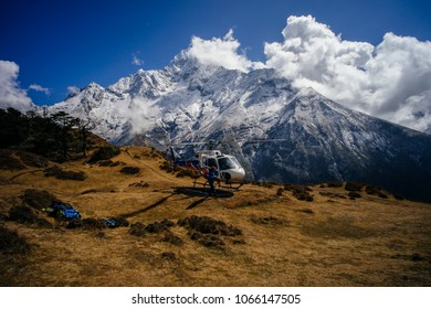 NAMCHE BAZAR, NEPAL-MARCH 17, 2017: Rescue helicopter landing near a hotel , 17 March 2017