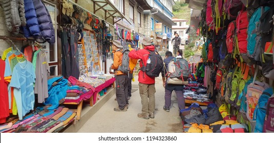 Namche Bazar,Nepal - Oct 1,2018 : backpacker and traveller looking at local shop in Namche Bazar,Nepal the 3,240 meters above sea level
