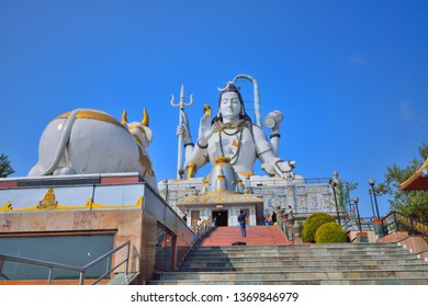 Namchi, India - November 19, 2018: People visiting Lord Shiva statue at Char Dham in Sikkim.