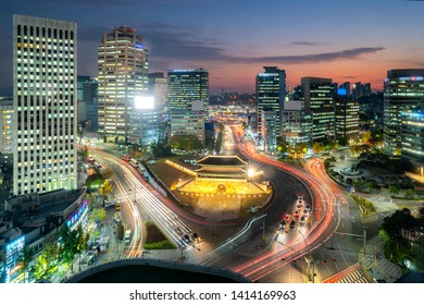 Namdaemun gate with Seoul business district at night in Seoul ,South Korea.