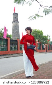 "NAMDINH, VIETNAM December 31, 2018: Beautiful girl wearing ""AODAI"" during the new year. ""AODAI"" is a traditional costume of Vietnamese women which is loved by many people."