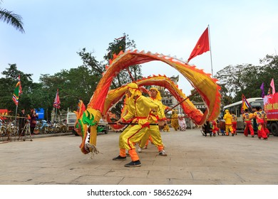 NAMDINH, VIETNAM - February 8, 2017: A group of unidentified boys dance with their colorful dragon during performances in performances of traditional street festival in NAMDINH City, VIETNAM.