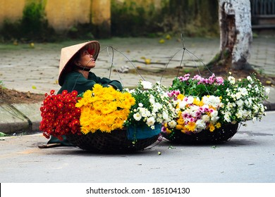 NAMDINH, VIETNAM - March 31: Unidentified small flower vendor at the flower market on March 31, 2014 in Namdinh, Vietnam. This is a small market for retail Florists and street vendors.