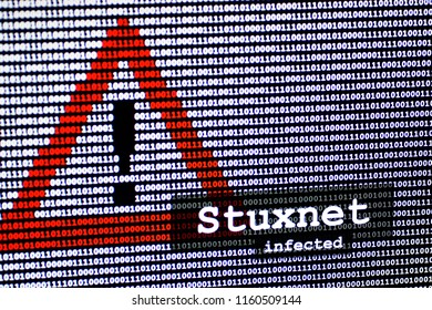 The name of the computer virus Stuxnet in front of a binary background