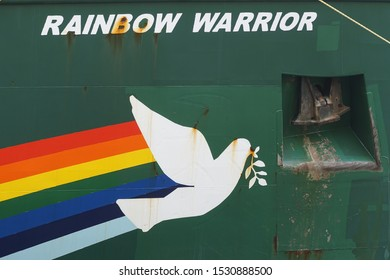 The name of Greenpeace's sailboat, the Rainbow Warrior, on the side of the ship, with an illustration underneath. Bergen, Norway - 13. October 2019
