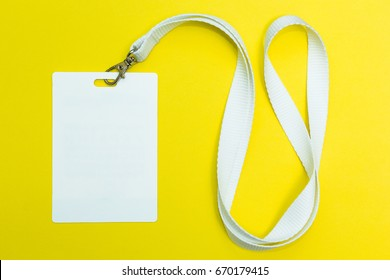 Name id card badge with cord on yellow background, empty space for text.