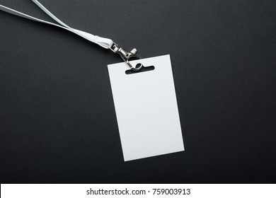 Name id card badge with cord on black background. White empty badge mockup / id card.