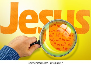 The name JESUS observed with magnifying glass shows My All in All. Religious concept image