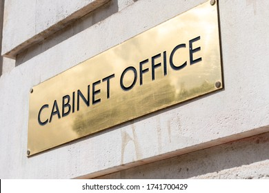 The name plate by the entrance of the Cabinet Office located in Whitehall, Westminster. This government department is responsible for supporting the UK Prime Minister and Cabinet.