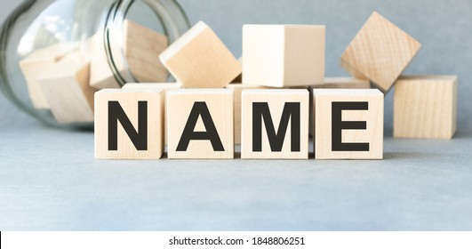 NAME word written on wood block. NAME text on wooden table for your desing, concept.