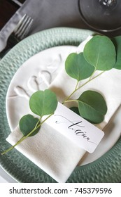 nameplate on a plate with a napkin. Waiting for guests for a festive dinner. Wedding decorations.