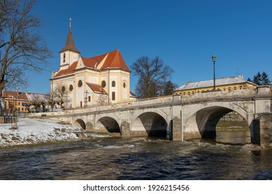 Namest nad Oslavou with the baroque bridge over river Oslava and Church of Saint John the Baptist - Shutterstock ID 1926215456