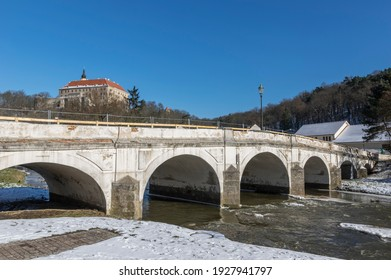 Namest nad Oslavou with the baroque bridge over river Oslava and the castle in the background. - Shutterstock ID 1927941797