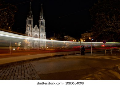 Namesti Miru (Peace Square) in Prague by night, long exposure with a passing tram