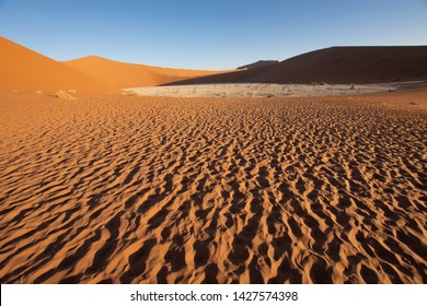 The Namib Desert in Namibia. Here the landscape overlooking Deadvlei pan at sunset.