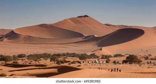 Namib desert, red dune Big Mama at Sossusvlei. Nature and landscapes of the desert. Annual growth of the area of sand. Global warming on the planet. Climatic changes on Earth.