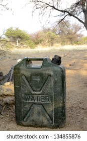 Namibia, Africa, September 25, 2011: Green jerrycan filled with water sits on the sand in Namibia, Africa.