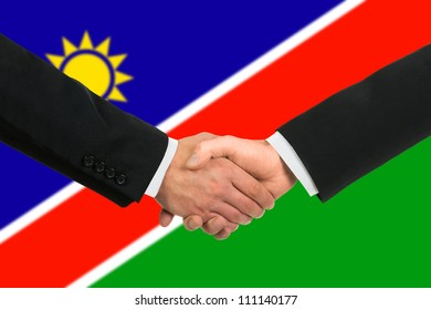 The Namibia flag and business handshake