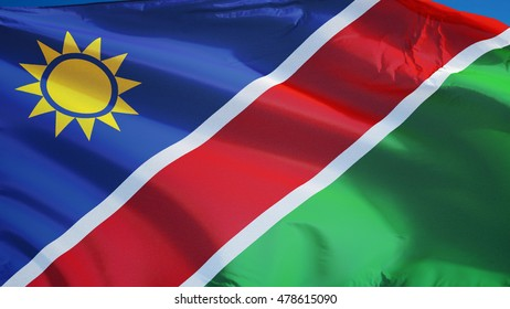 Namibia flag waving against clean blue sky, close up, isolated with clipping path mask alpha channel transparency