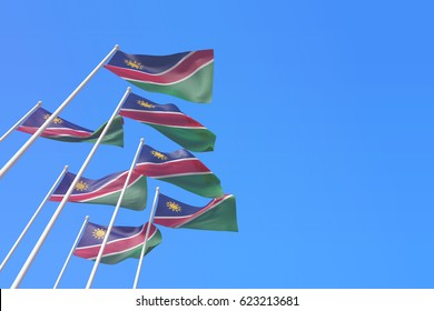 Namibia flags waving in the wind against a blue sky. 3D Rendering