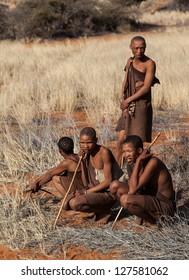 NAMIBIA - JULY 11: Bushmen preparing for hunt in the kalahari desert in Namibia on July 11, 2009.