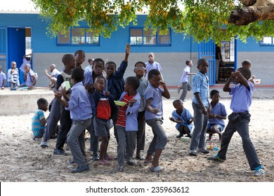 NAMIBIA, KAVANGO, OCTOBER 15: Happy Namibian school children waiting for a lesson. Kavango was the region with the highest poverty level in Namibia. October 15, 2014, Namibia