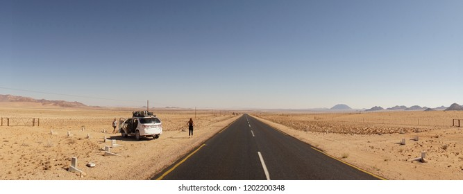 Lüderitz / Namibia - May 21: Traveler on a highway in the Namib Desert in the jeep, Namibiba.