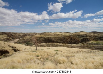 A namibian landscape with hills and dried grass