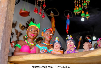 Namoradeira is a woman looking at street waiting in the window a boyfriend arrived, Brazilian handicraft made with adobe and a colonial traditional sculpture. Pirenópolis, Goiás, Brazil.