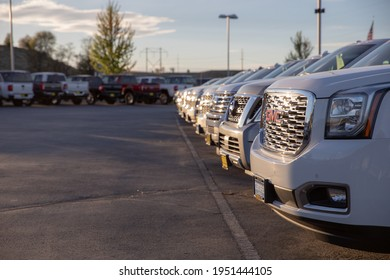 NAMPA, IDAHO - APRIL 28, 2020: Row of GMC vehicles ready and waiting for sale at a Nampa Chevrolet dealership