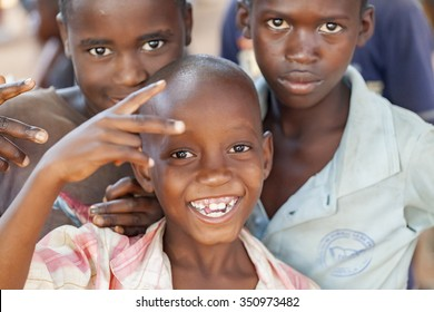NAMPULA, MOZAMBIQUE - OCTOBER 11, 2014: Cheerful and happy children from northern Mozambique
