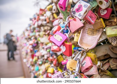 Namsan Park, Seoul - 13 April, 2015 : Love locks, lovers hug at the background, with vintage effect