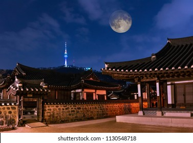 Namsangol Hanok Village with Full moon and seoul tower in Seoul South Korea