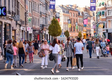 Namur, Belgium. Sept 21, 2019. Shopping street in city center of Belgian city Namur. People with shopping bags walking in pedestrian street. Crowded street with shops in Namur, Belgium.