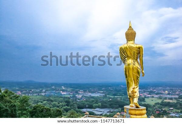 Nan - June 19, 2018 : A walking Golden Buddha Specific characteristics in nan temple at Wat Pra That Khao Noi , Nan Thailand.