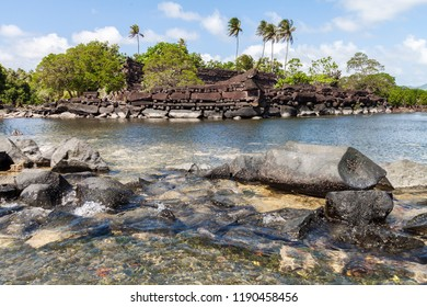Nan Madol prehistoric ruined stone city built of basalt slabs, overgrown with palms. Ancient walls built on coral artificial islands linked by canals in a lagoon of Pohnpei, Micronesia, Oceania