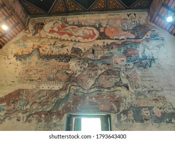 Nan, THAILAND - 26 July 2020 : The murals paintings on the wall inside the main chapel of Nong Bua temple in Nan province.