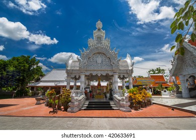 NAN, THAILAND - APRIL 24, 2016 : Nan city pillar shrine in Wat Ming Meuang and blue sky white clouds background. Editorial use.