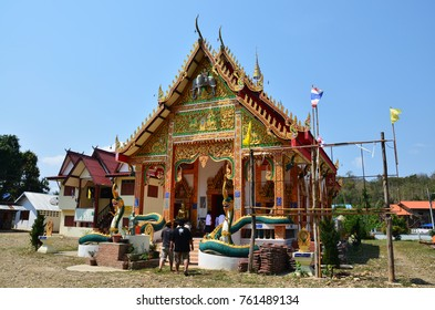 NAN, THAILAND - APRIL 29 : Travlers thai people go to Wat Don Moon temple for praying and respect Buddha statue inside Ubosot at countryside Pua District on April 29, 2011 in Nan, Thailand