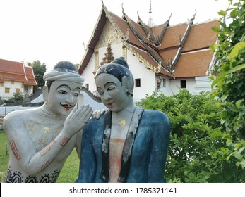 NAN, THAILAND - July 25, 2020: The statue of a man whispering to the ear of a woman at Phumin Temple in Nan province, Thailand..