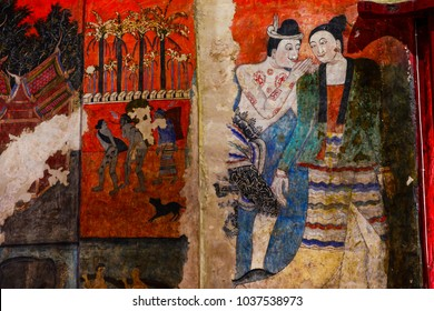 NAN ,THAILAND - March 1, 2018 :The famous mural painting of a man whispering to the ear of a woman. at Wat Phumin, a famous temple in Nan province, Thailand.